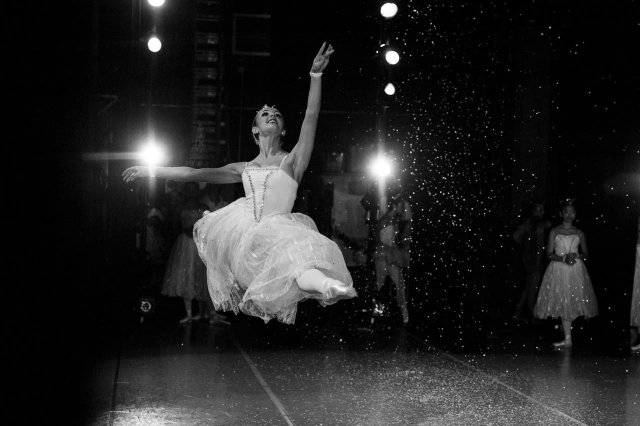 Dance studio student Sarah Takash is captured here in mid air by resident photographer and faculty member, Sori Gottdenker, during the Snow Scene of Nutcracker