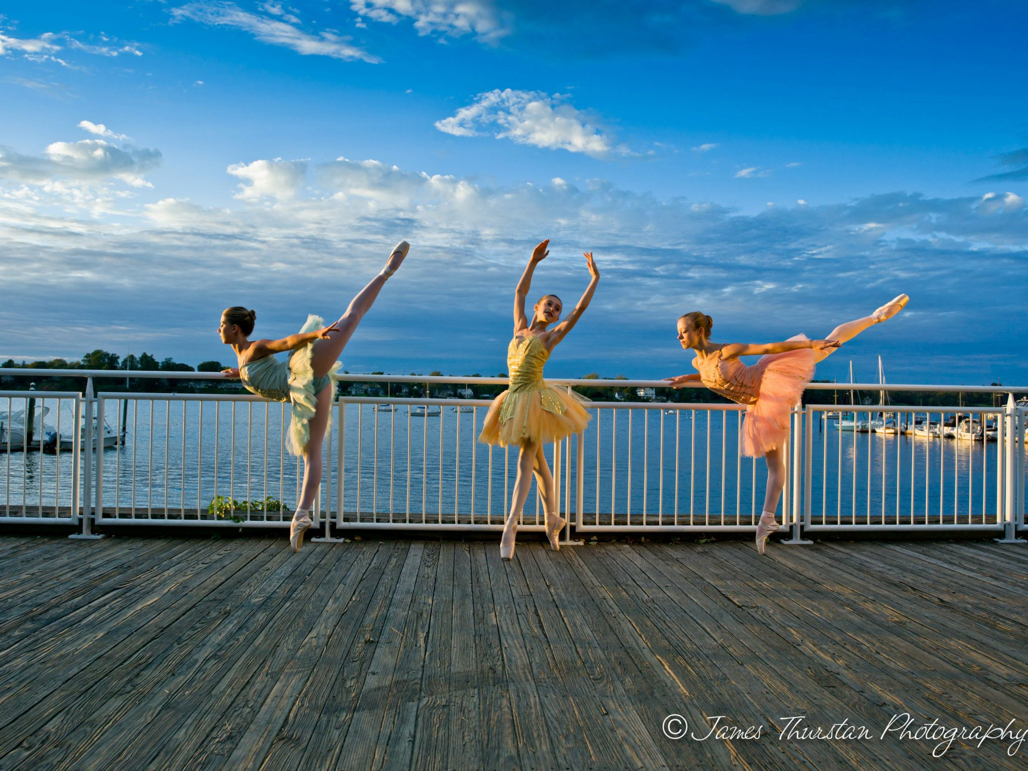 Advanced dance studio Students striking a pose on the dock