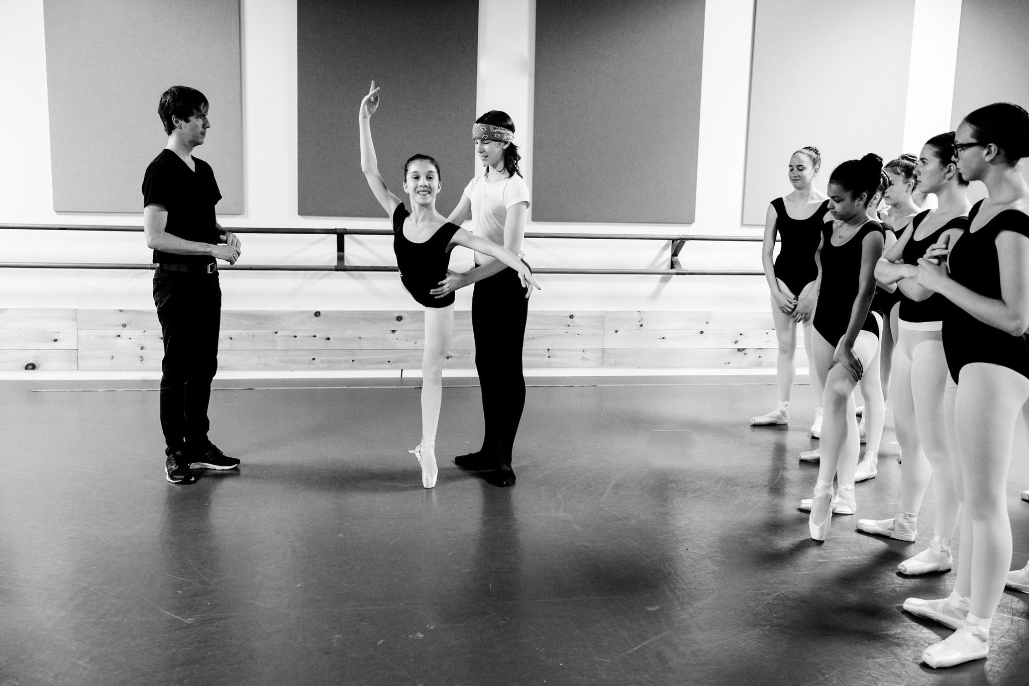 Photo by in house photographer Sori Gottdenker of Mr Mishoe correcting students in the dance studio during his Intermediate level Ballet Partnering class