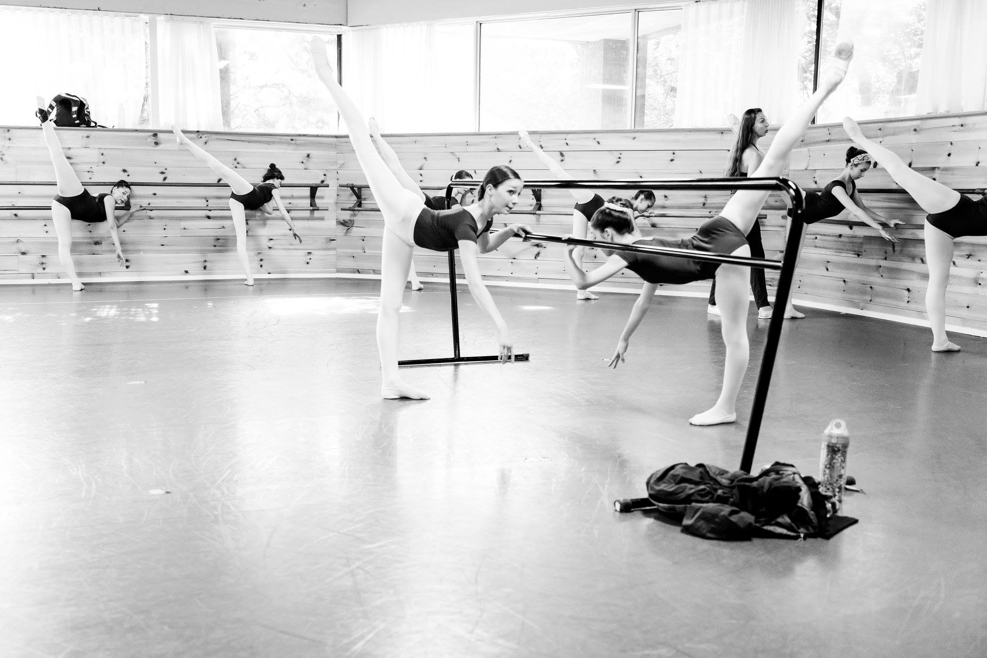 Photo by in house photographer Sori Gottdenker of Mrs Mishoe correcting a student in the dance studio during her Intermediate level Ballet class