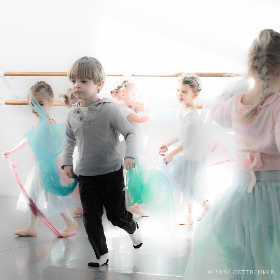 Photo by in house photographer Sori Gottdenker of 3-4 year old students enjoying moving with their scarves in the dance studio during Pre Ballet class